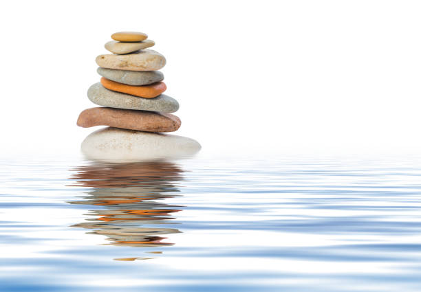 Stack of stones in water stock photo