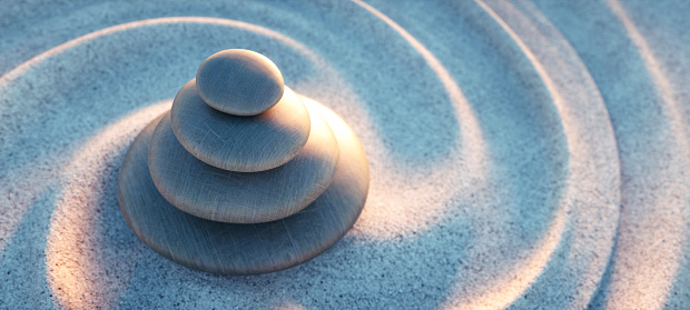 Stack of pebbles with spiral sand waves
