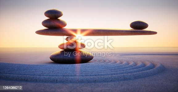 Stack of Stones with seesaw in the evening sun