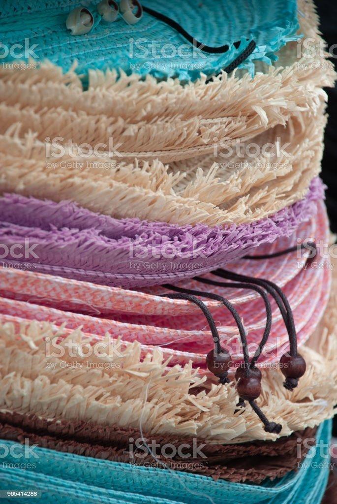 Stack of  straw hats zbiór zdjęć royalty-free