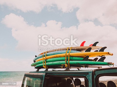 Stack of surfboards on a van roof // mobile stock photo, made with iPhone 8