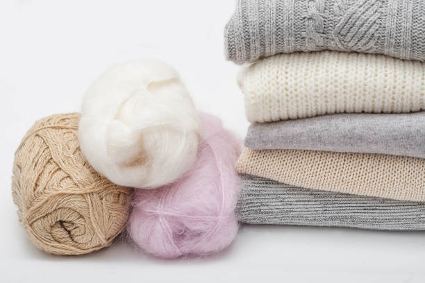 stack of sweaters and wool solated on white - caxemira imagens e fotografias de stock