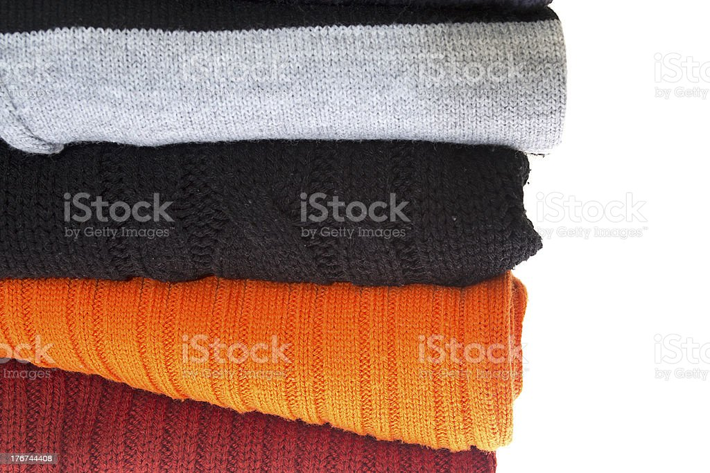stack of sweaters isolated on a white royalty-free stock photo
