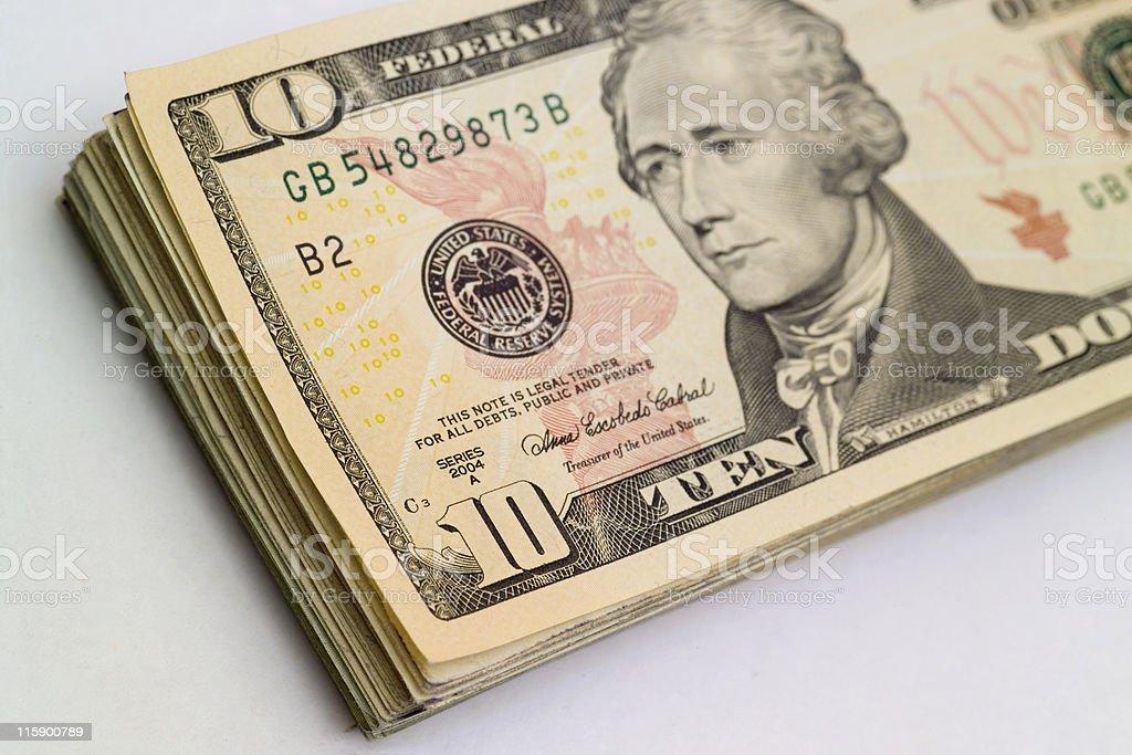 Stack of ten dollar bills stock photo