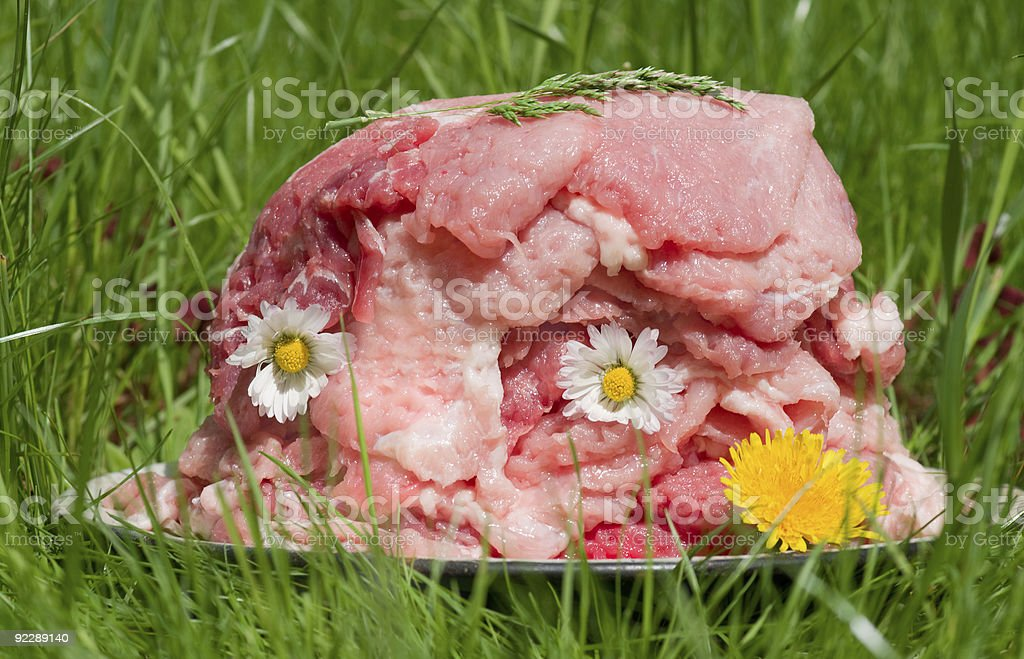 Stack of tender beef steaks with flowers and herbs royalty-free stock photo