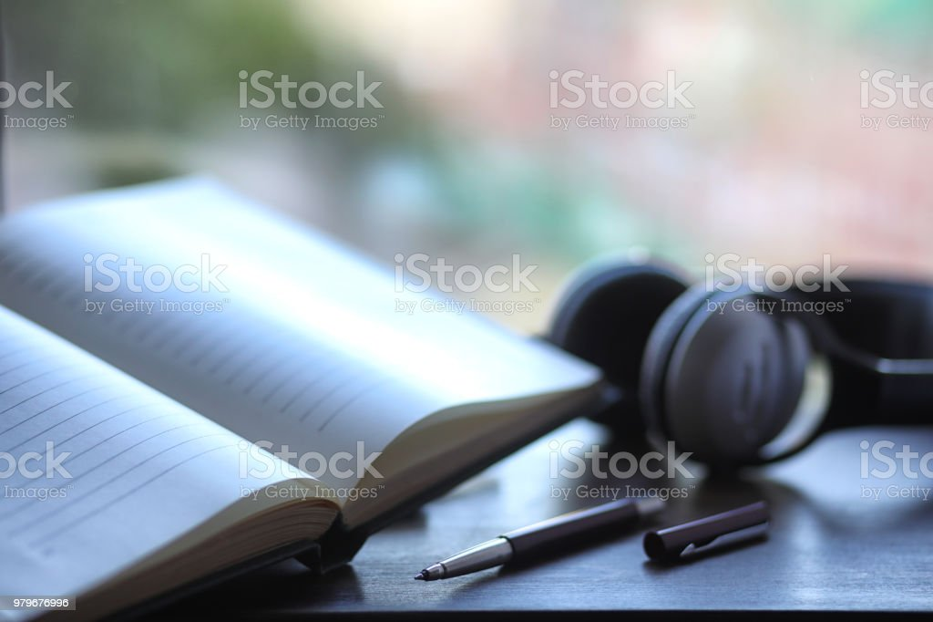 A stack of textbooks headphone stock photo