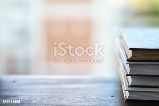 istock A stack of textbooks on the windowsill 899011506