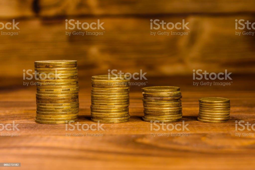 Stack of the coins on wooden table zbiór zdjęć royalty-free