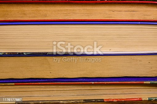 1034955096 istock photo Stack of the different old books for background 1176177887