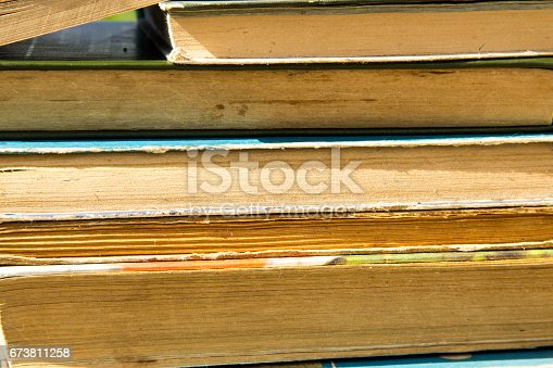 1034955096 istock photo Stack of the old books. Books background 673811258