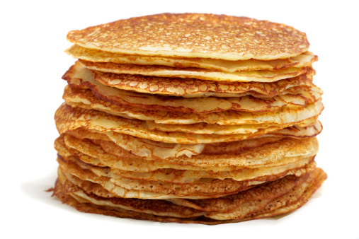 Stack Of Thin Pancakes On A White Background Stock Photo - Download Image Now