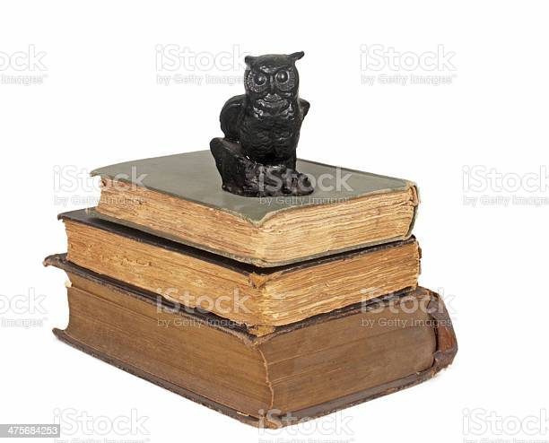 Stack of three antique books with owl statue picture id475684253?b=1&k=6&m=475684253&s=612x612&h=qynknkhhiv0auvbw3qit3otvcbunnm2xioc1z y0dyg=