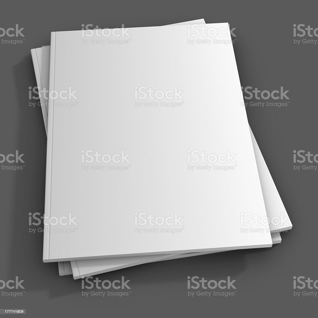 A stack of three blank magazine covers on a gray table stock photo