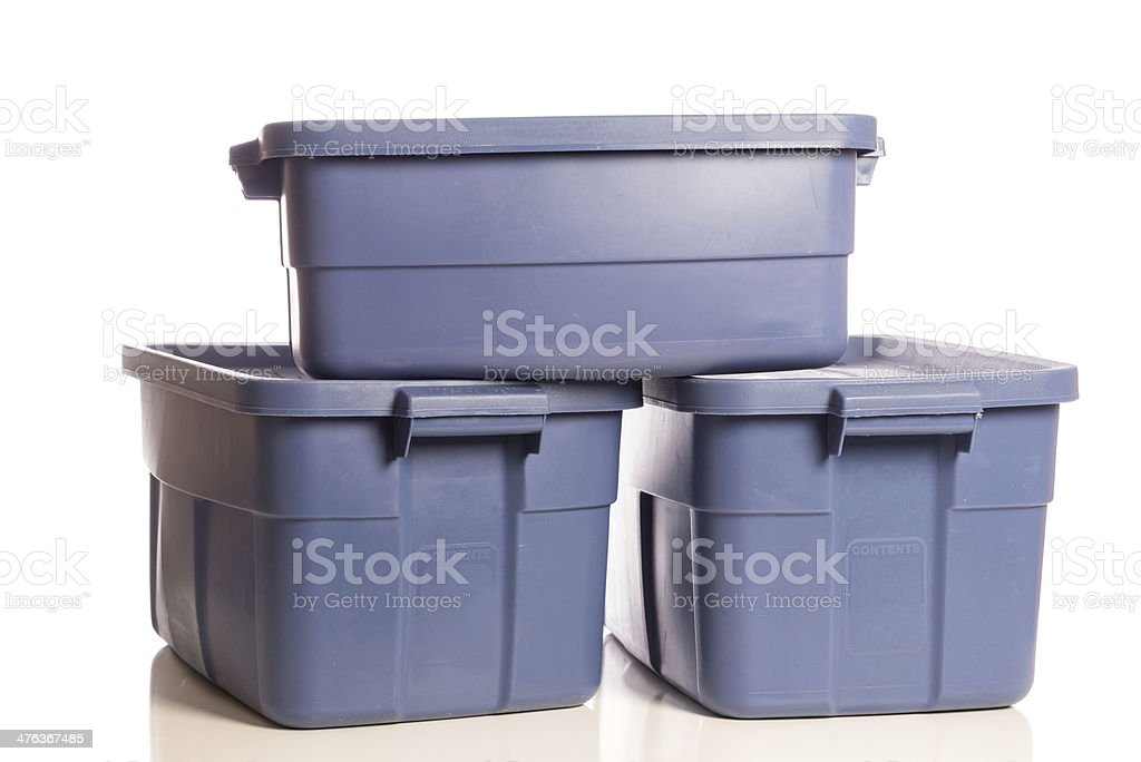 Stack of three blue storage tubs stock photo