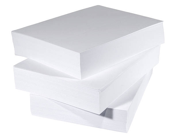 Stack of three solid white large reams of paper stock photo
