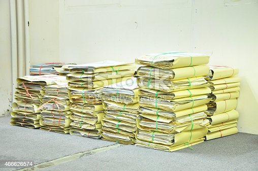 177170883 istock photo Stack Of Tied Old Files Yellowing On Office Floor 466626574