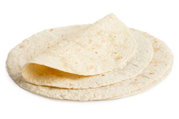 stack of tortilla wraps and one folded wrap. - tortilla stock photos and pictures