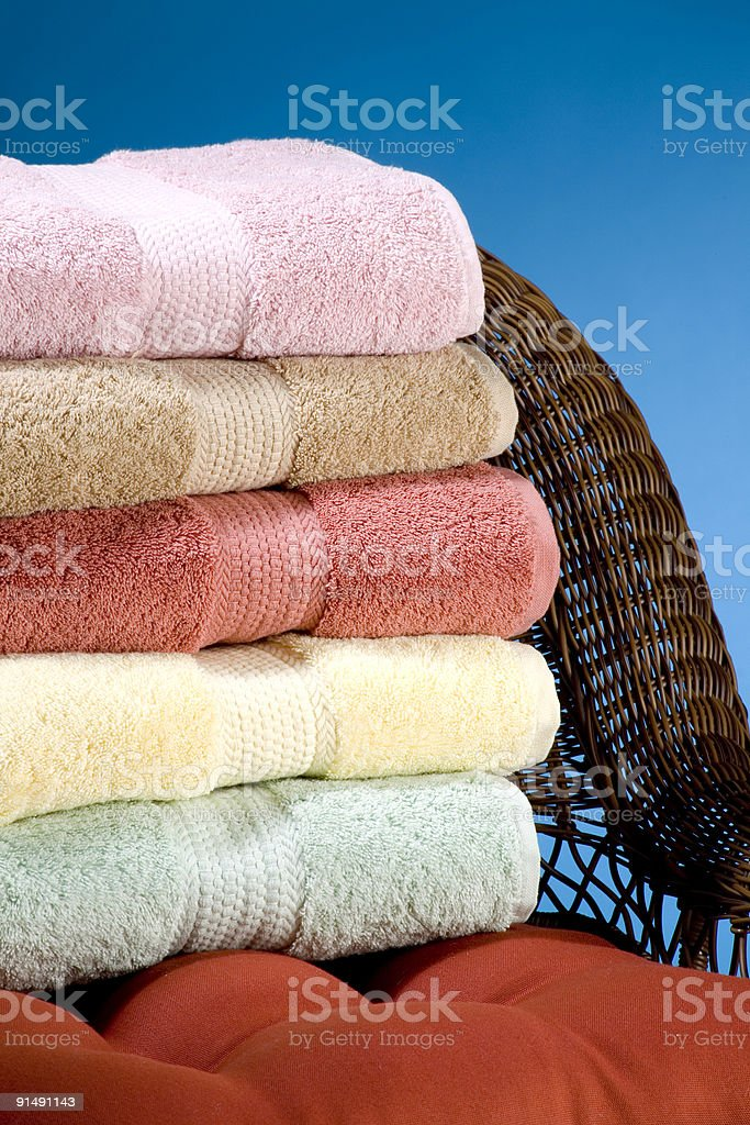 Stack of towels on a wicker chair stock photo