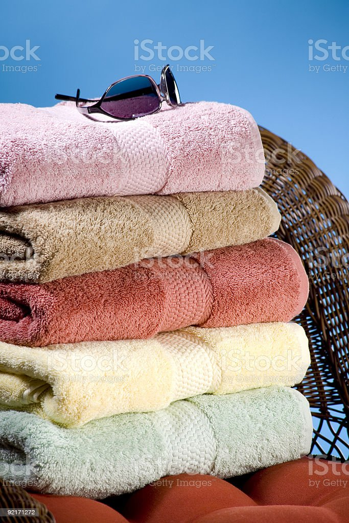 Stack of towels with sunglasses stock photo