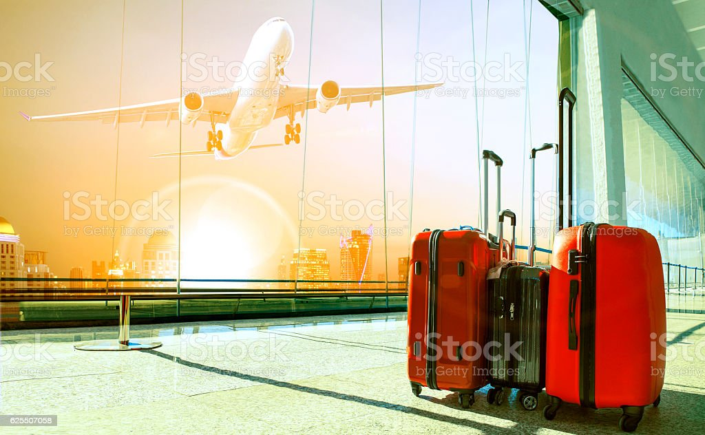 stack of traveling luggage in airport terminal building and pass stock photo
