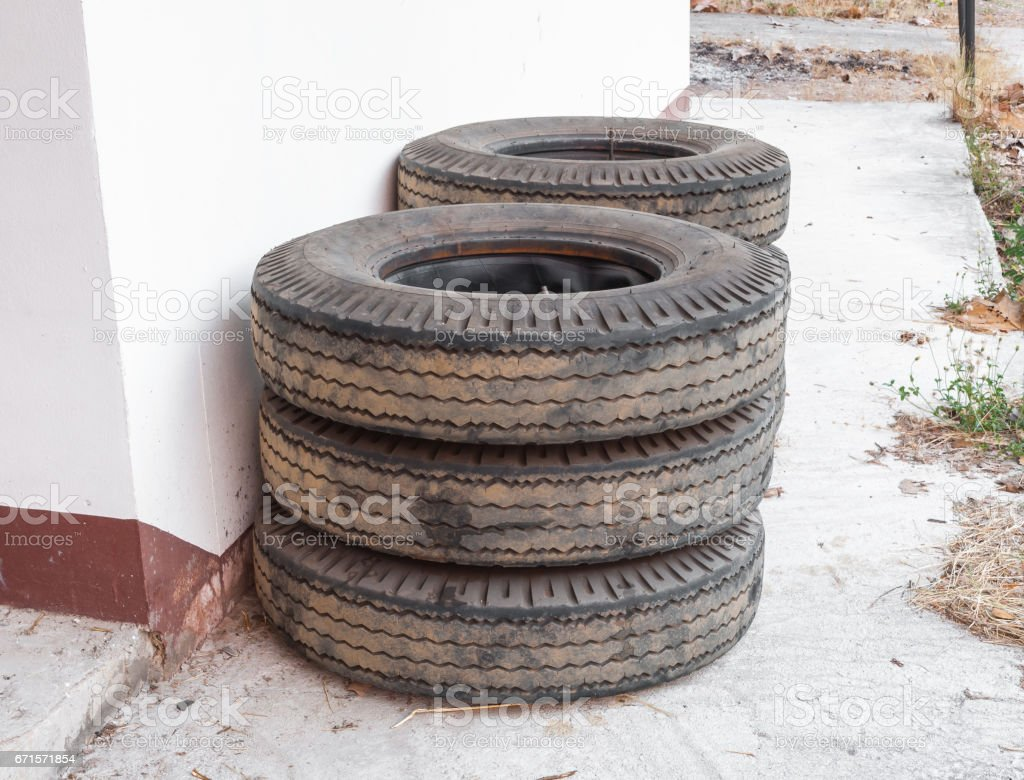 Stack Of Truck Tyres On Concrete Ground Stock Photo - Download Image