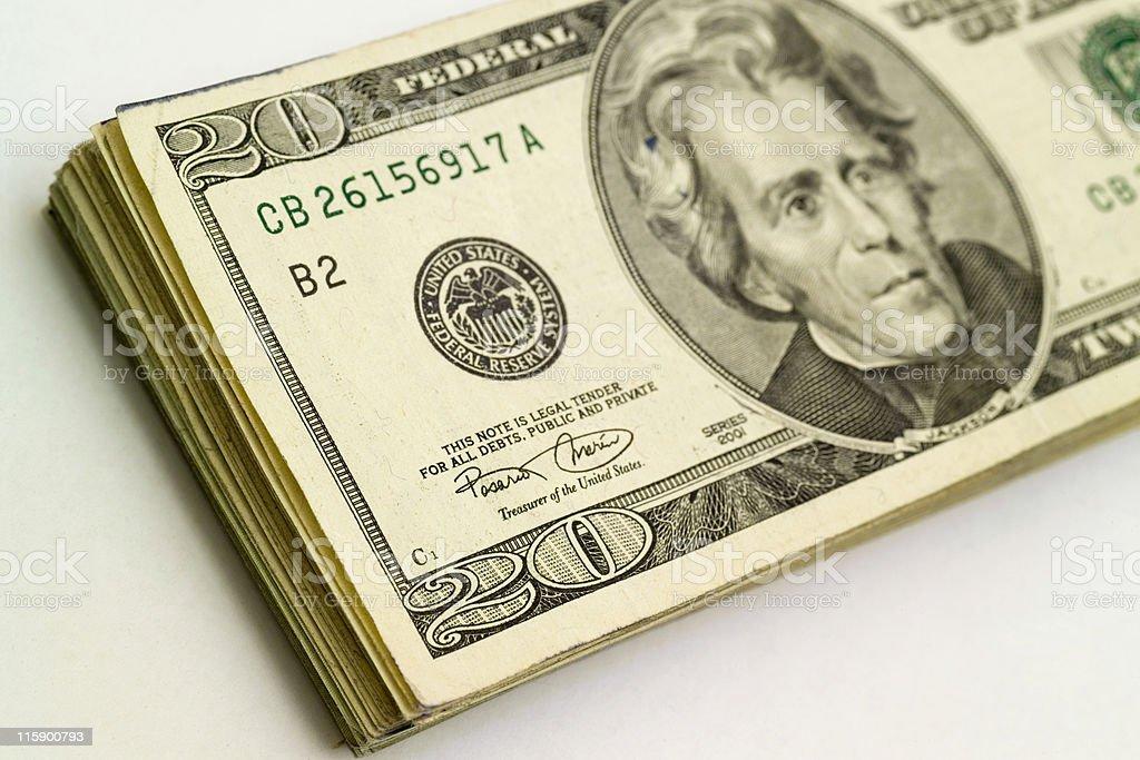 Stack of twenty dollar bills stock photo