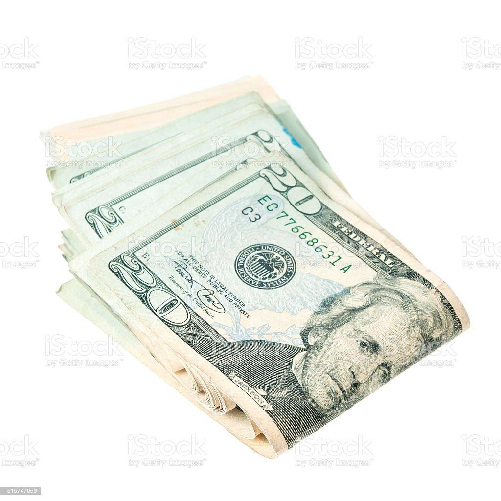 Stack of twenty dollars on white background. stock photo