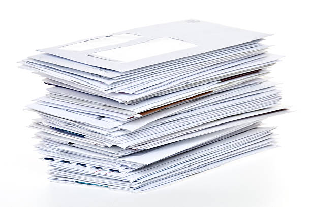 stack of unpaid bills and envelopes isolated on white - hög bildbanksfoton och bilder