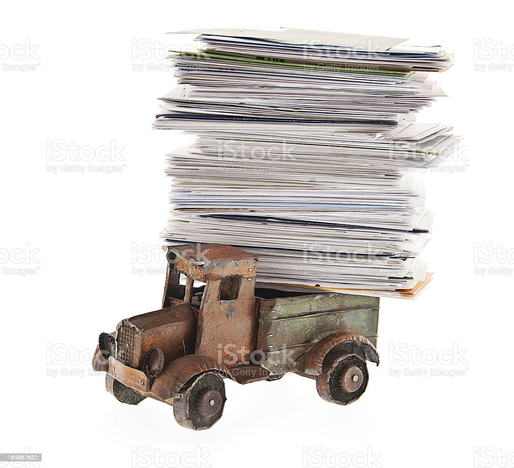 Stack of Unpaid Bills and Envelopes Loaded on Toy Truck royalty-free stock photo