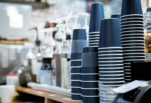 Stack of upside down disposable cups at cafe