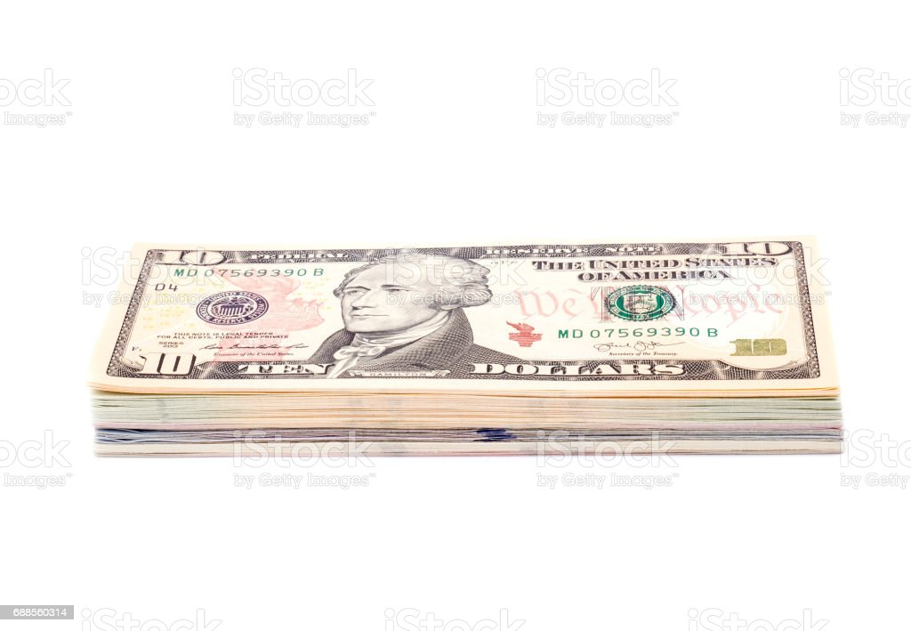 Stack of US Dollar Bills With 10 Dollar Bill on Top Isolated stock photo