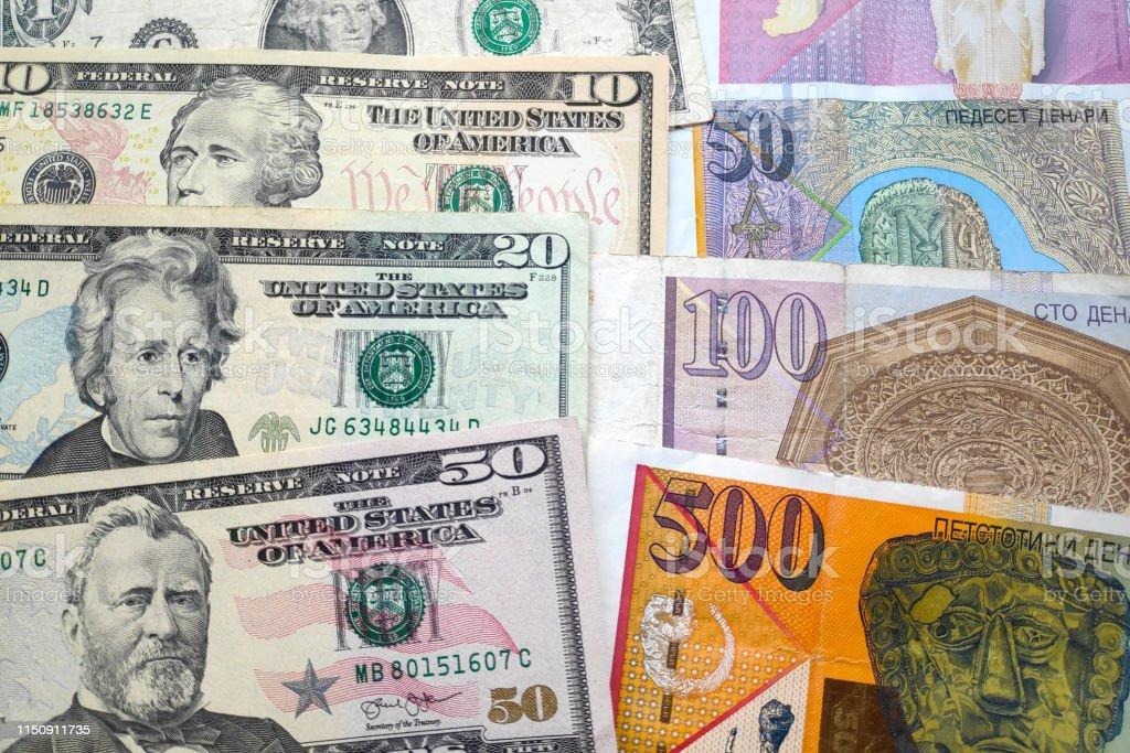 Stack of US Dollars & Macedonian Denar stock photo