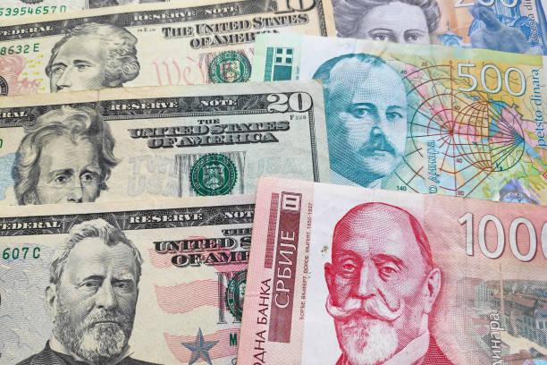 Stack of US Dollars & Serbian dinar stock photo