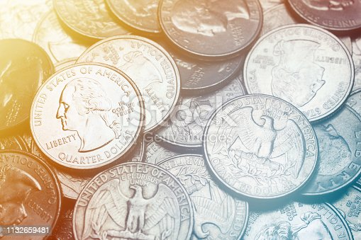 Close-up in many US quarters coin background.