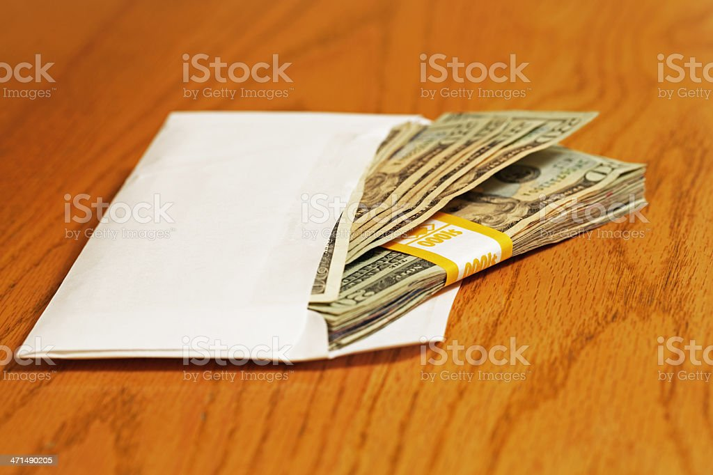 Stack of US Twenty Dollar Bills in Envelope royalty-free stock photo