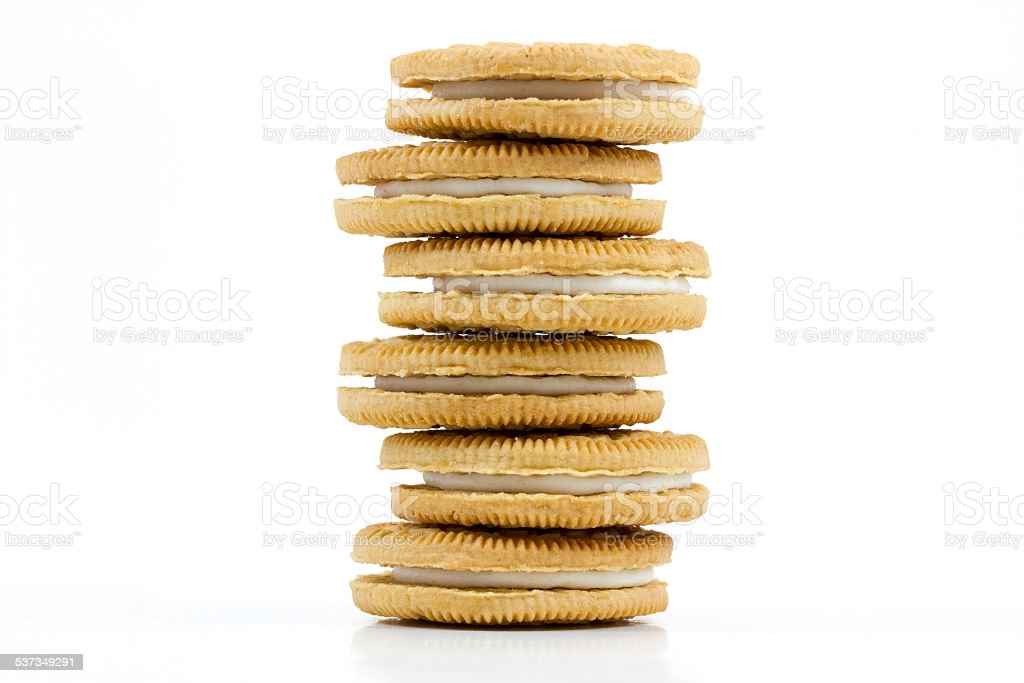 Stack of Vanilla cookies with cream filling on white background stock photo