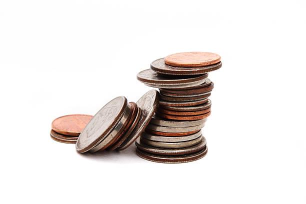Stack of various coins closeup stock photo