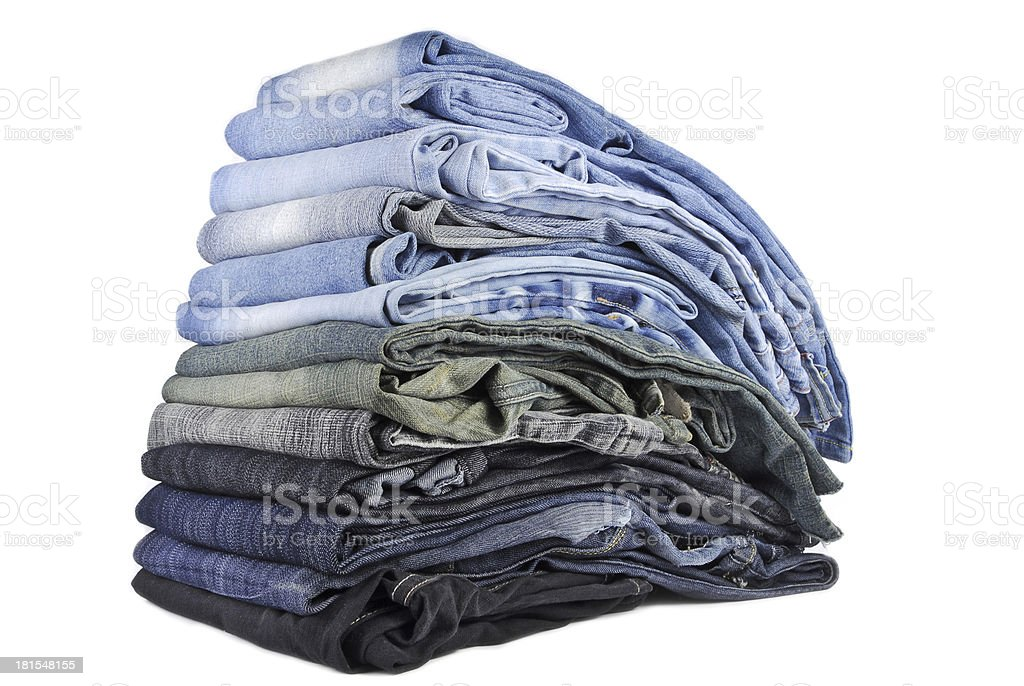 stack of various jeans isolated on white background royalty-free stock photo