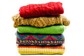 Stack of various sweaters. Winter style