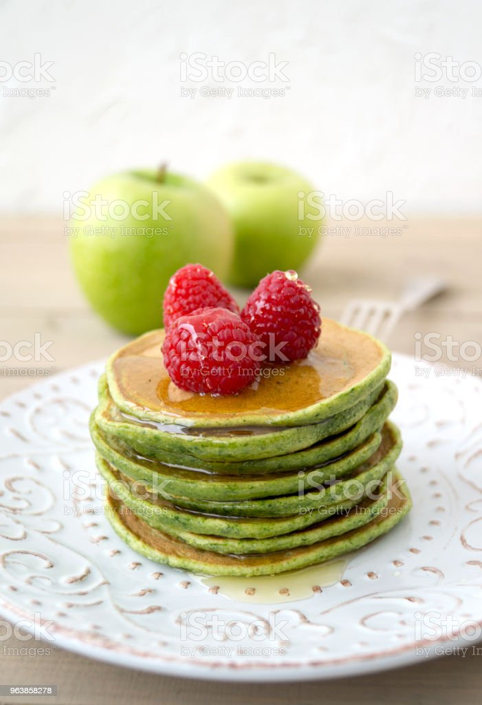 A stack of vegetarian pancakes with honey and raspberry. - Royalty-free Baked Pastry Item Stock Photo