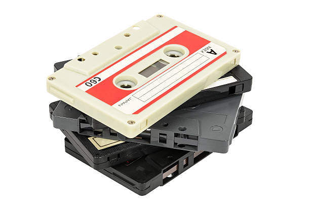 Stack of vintage audio tapes on white background stock photo