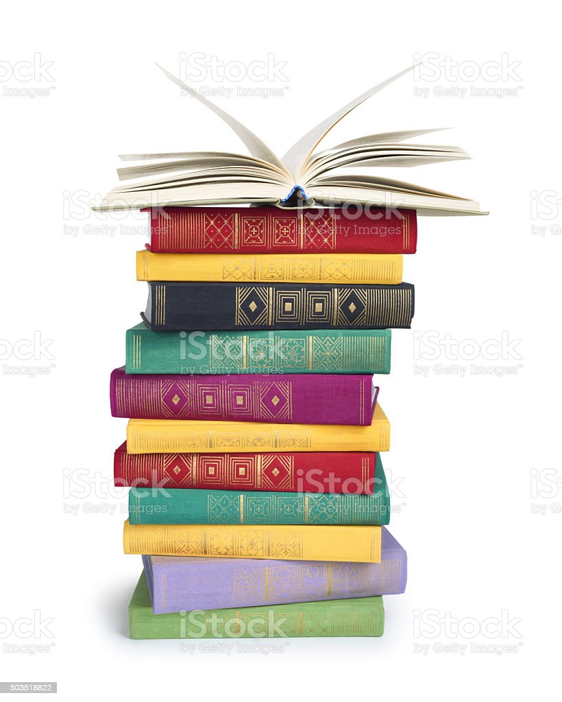 stack of vintage books with open top stock photo