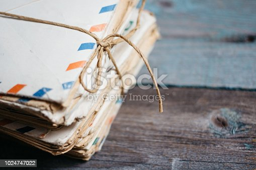istock Stack of vintage letters on wooden table 1024747022