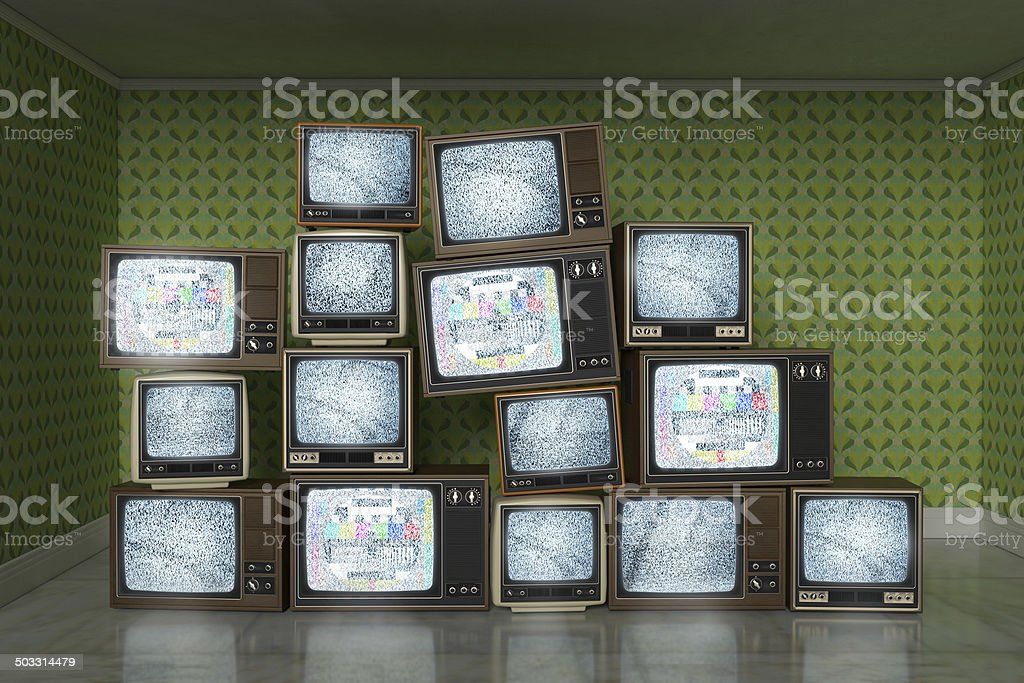 Stack of vintage old televisions showing static signal, test pattern stock photo