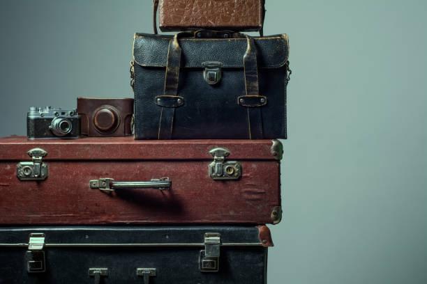 stack of vintage shabby suitcases - nachrichten video stock-fotos und bilder