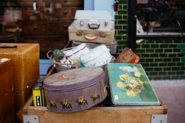 Stack of vintage suitcases and various vintage items in Chatsworth Road Market, London, UK. London, UK - March 20, 2016: Stack of vintage suitcases and various vintage items in Chatsworth Road Market. The market has a long heritage and is located on one of London's longest high streets. sentimentality stock pictures, royalty-free photos & images