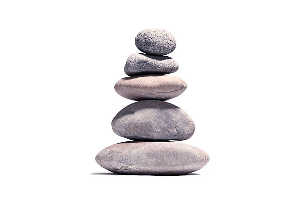 stack of volcanic pebbles isotaded on white with clipping path - stack rock stock pictures, royalty-free photos & images