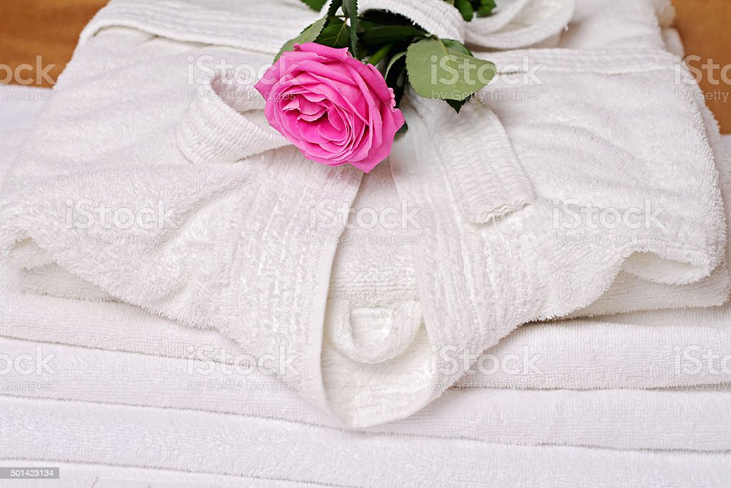 Stack of white  and soft hotel towels and bathrobe stock photo