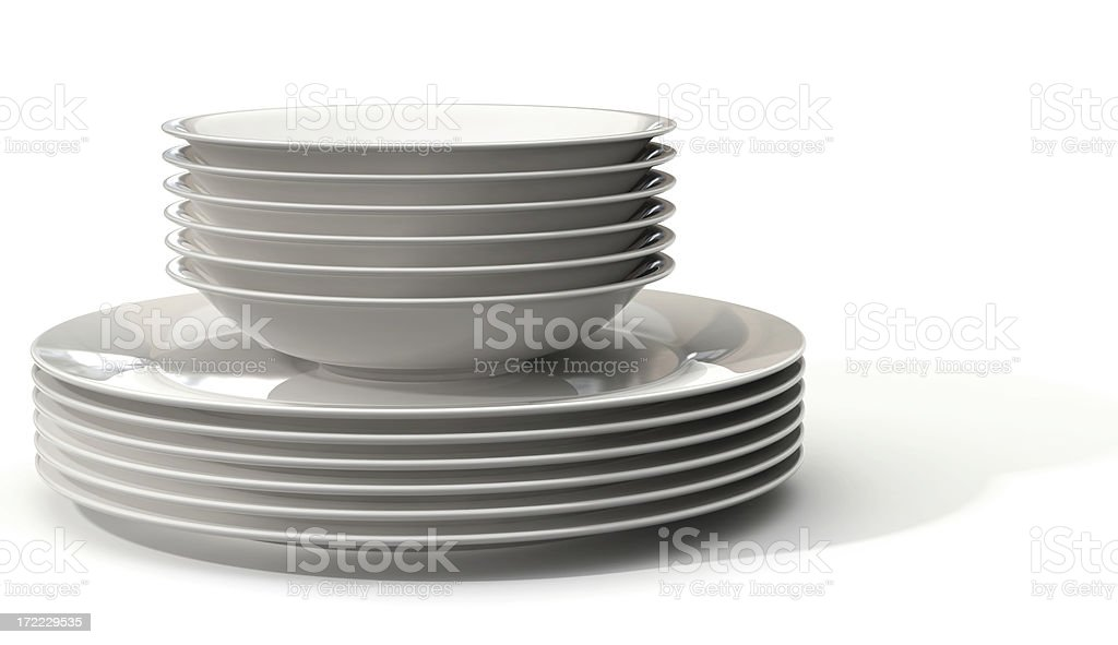 A stack of white bowls on a stack of white plates royalty-free stock photo