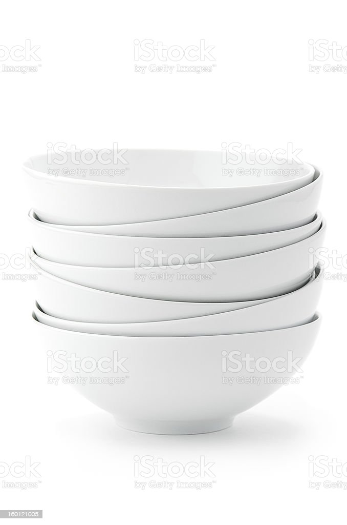 Stack of white bowls on white background stock photo